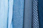 Different Clothing Textures Of Fine Shirt Cloth At A Tailor Shop. Colorful Fabric. Clothing Design F poster