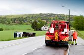 stock photo of tow-truck  - A tow truck arrives on the scene of an accident - JPG
