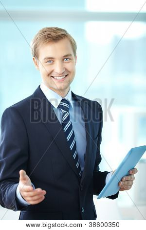Portrait of cheerful boss in suit looking at camera