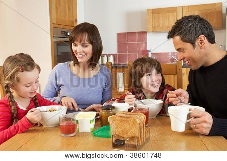 Family Eating Breakfast Together In Kitchen