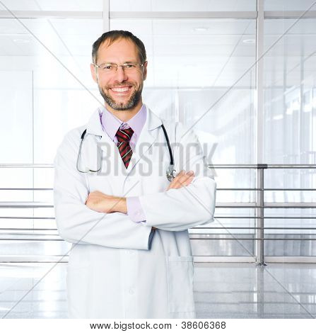 medical doctor with stethoscope over clinic  background
