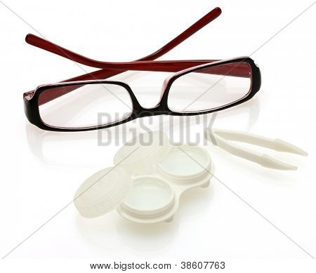 glasses, contact lenses in containers and tweezers, isolated on white