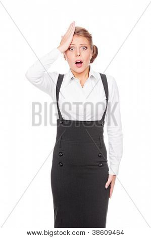 portrait of young emotional businesswoman with her hand on her forehead