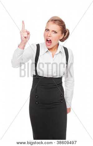angry businesswoman shaking her finger and shouting. studio shot over white background