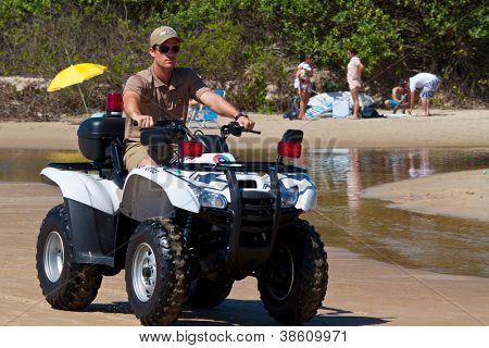 FLORIANOPOLIS, BRAZIL - FEB 3: A police officer patrols the beach to keep visitors safe on Feb 3, 2012 in Florianopolis, Brazil.