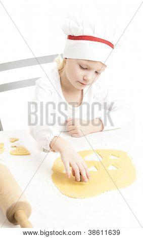 little girl cutting cookies