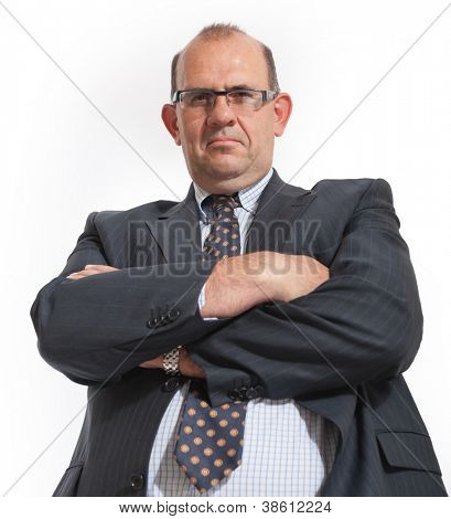 Imposing man in business attire with arms crossed