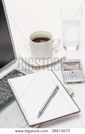 Business workplace pen notepad laptop phone coffee on office desk