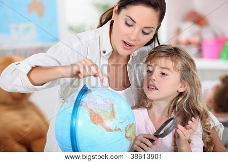 little girl learning geography with mom
