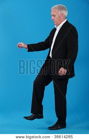 Businessman stepping on an insect