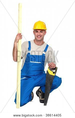 Man with a handsaw and a piece of wood