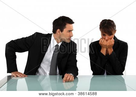 Businessman reassuring scared colleague