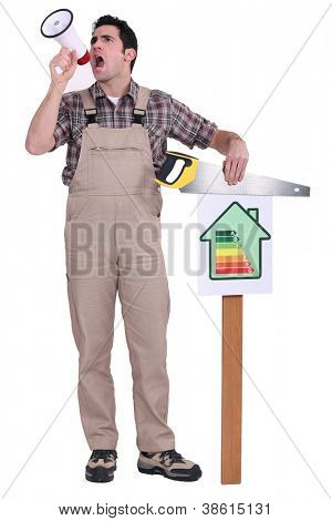 Man blowing into a megaphone and holding a saw over an energy efficiency rating chart