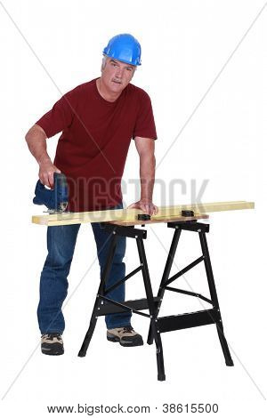 Carpenter cutting piece of wood to size