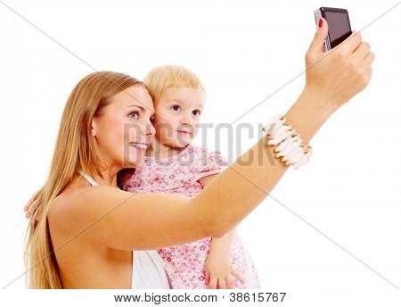 Pretty young mother with cute baby on her hands taking photograph of themselves. Isolated on white background, mask included