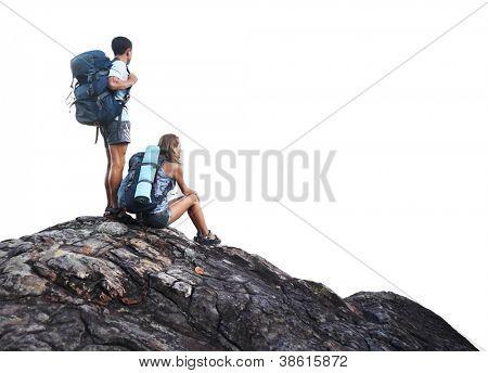 Zwei Wanderer mit Rucksäcken auf einem Berg isoliert auf einem weißen