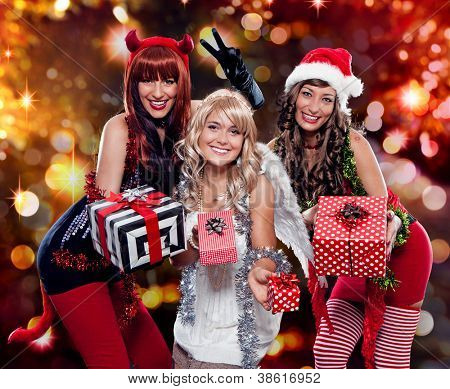 devil, angel and santa giving gifts