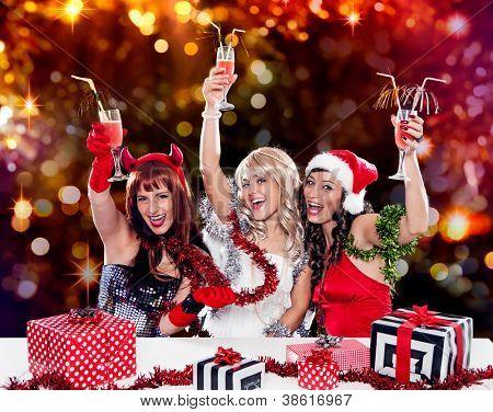 devil, angel and santa celebrating together