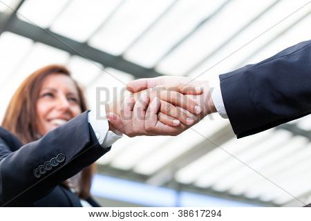 Businesspeople shaking hands at the office