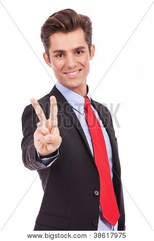 bright picture of handsome business  man showing victory sign