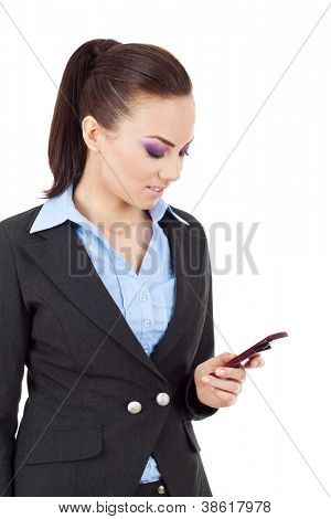 portrait of a happy young business woman texting from her cellphone against white background