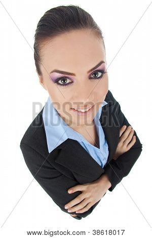 top view of an awesome young business woman looking at you with her arms folded, isolated on white