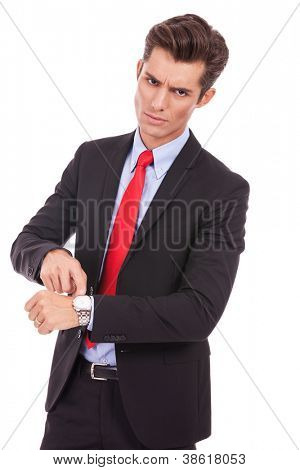 Business man impatiently pointing to his watch telling you that you are late. Isolated on white.