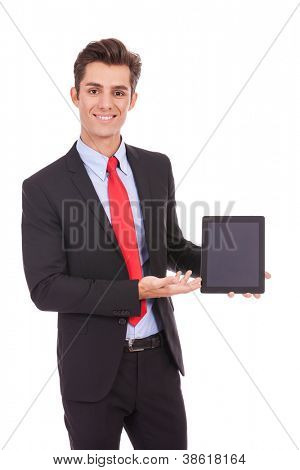 smiling business man showing you his tablet pad on white background
