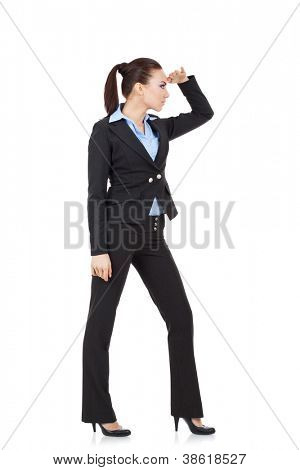 full length picture of a young business woman looking far away, over a white background