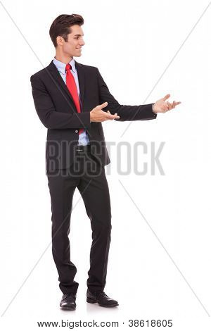 Business man presenting something or inviting you in on white background