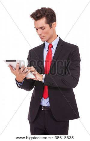 young business man working on his tablet pad on white background