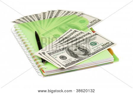 Heap of dollars and exercise book isolated on a white background