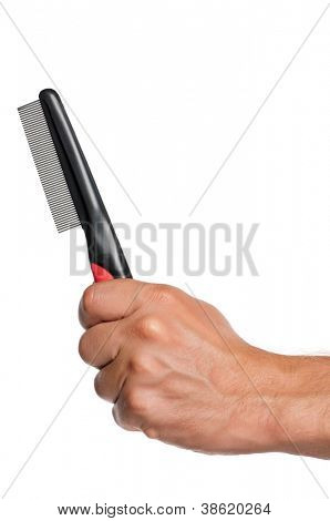 Man hand with pets comb isolated on white background