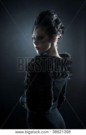 Portrait of female vampire over dark background