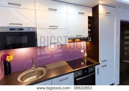 Modern white and purple kitchen interior