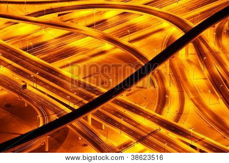 Picture of beautiful road at night, aerial view on highway in Dubai downtown, united arab emirates, conceptual of luxury tourism, illuminated expressway road in evening, new way architecture