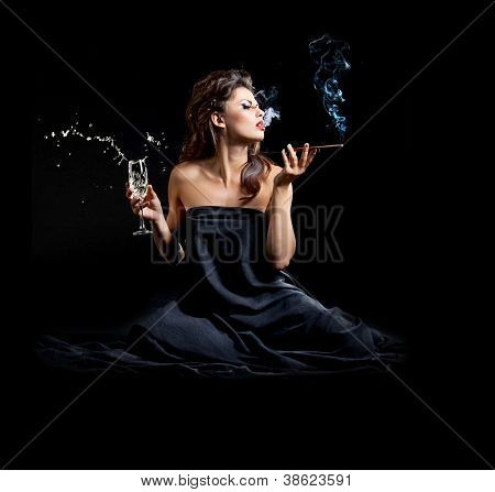 Glamour women with champagne and cigarette on black background