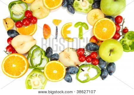The word Diet lined with pieces of fruits and vegetables isolated on white