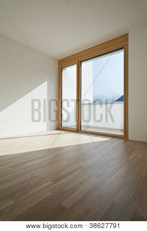 empty room with window and parquet