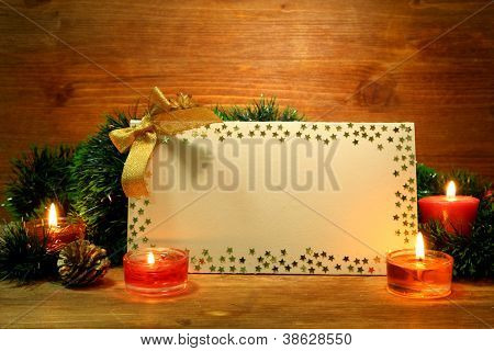 beautiful Christmas composition with empty postcard on wooden background