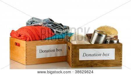 Donation boxes with clothing and food isolated on white