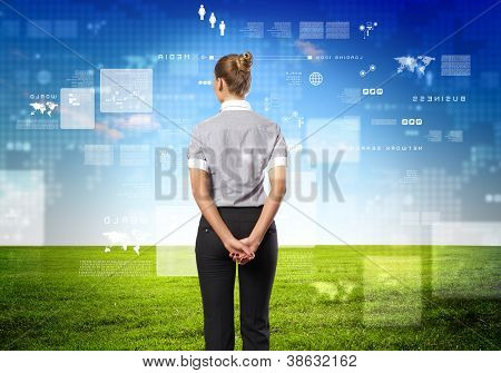 Business person standing against modern virtual technology background