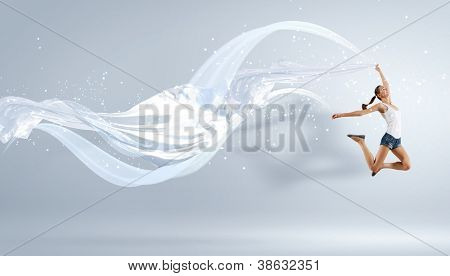 Modern style female dancer jumping and posing with lighting