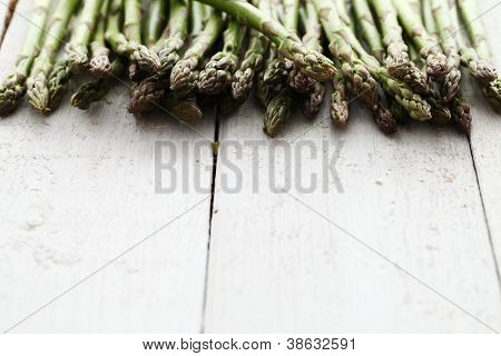 Close up of fresh green asparagus on wooden table