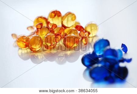 Close up of gelatin pills over glass surface