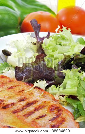 closeup of a combo platter with grilled chicken and green salad