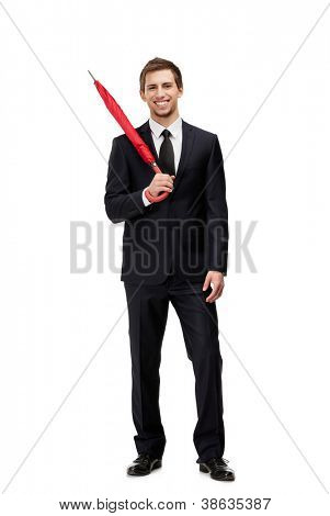 Standing man with closed red umbrella, isolated on white