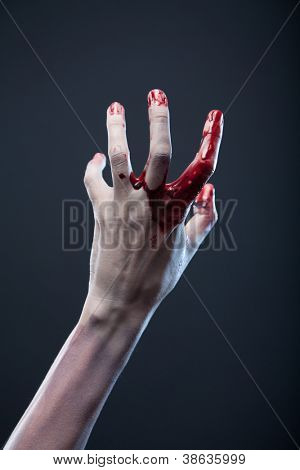 Bloody zombie hand, extreme body-art, studio shot