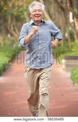 Senior Chinese Man Jogging In Park