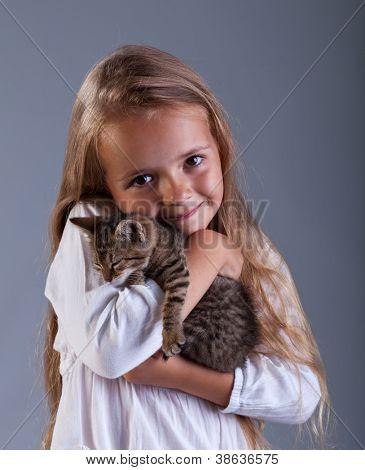 I love my kitten - little girl holding her new pet